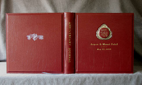 custom red leather anniversary journal with indian style inlaid brass