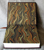 dark brown leather cowboy boots and monogram anniversary journal marbled endpapers