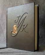 dark brown leather cowboy boots and monogram anniversary journal standing