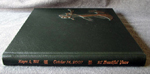 dark green leather dancing couple anniversary guest book spine