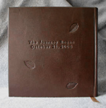 dark brown leather falling leaves anniversary journal back cover