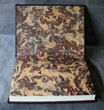 custom dark brown leather celtic cross journal marbled endpapers