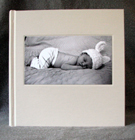 eggshell linen baby album with black and white portrait front cover