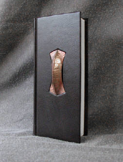 dark brown goatskin leather journal with fold formed copper