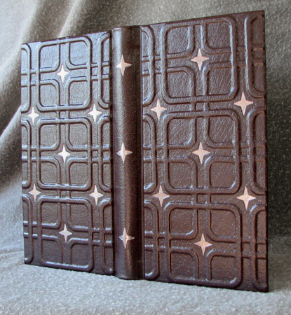 leather journal mid century modern wallpaper design with stars