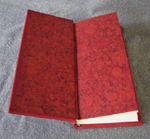 custom red leather journal with hand forged fold formed copper marbled endpapers