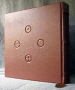 custom rust leather book of shadows with carved green man and elemental symbols back cover