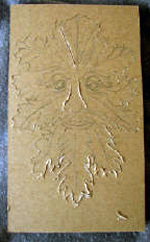 custom rust leather book of shadows with carved green man and elemental symbols carving 1