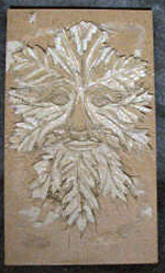 custom rust leather book of shadows with carved green man and elemental symbols carving 2