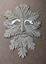 custom rust leather book of shadows with carved green man and elemental symbols carving 3
