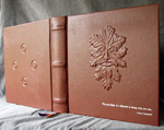 custom rust leather book of shadows with carved green man and elemental symbols whole cover