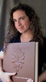 custom rust leather book of shadows with carved green man and elemental symbols with bookbinder Tedra Ashley-Wannemuhler