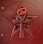 custom burgundy leather book of shadows with pentacle ankh eye symbols carved front detail