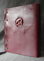 custom burgundy leather book of shadows with pentacle ankh eye symbols and leather wrap front 2