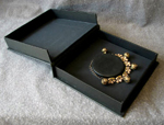custom leather modified clamshell box with red kimono to hold xena costume anklet open