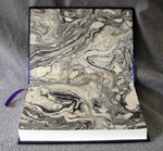 custom black and purple leather cookbook with bowl of stars marbled endpaper