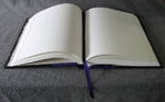 custom black and purple leather cookbook with bowl of stars open pages