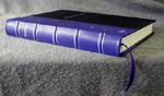 custom black and purple leather cookbook with bowl of stars spine