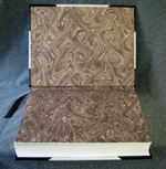 three quarter binding engagement ring book endpapers