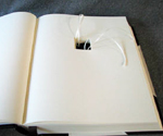 three quarter binding engagement ring book open