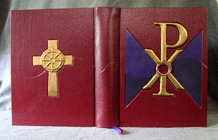 red leather religious symbol cover with purple goatskin and gold copper inset XPI dharma wheel mediation cross whole cover
