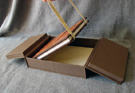 custom cloth covered clamshell box for book with antique hardware latch open 4
