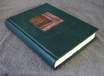 custom green leather kilt making record book with inset fold formed copper tartan pattern emblem spine