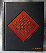 custom black leather meditation journal with two front covers and raised designs front cover 2
