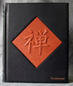custom black leather meditation journal with two front covers and raised designs front cover 1