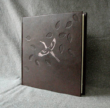custom dark brown crane and blowing leaf album