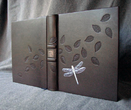 custom brown leather dragonfly and blowing leaves journal