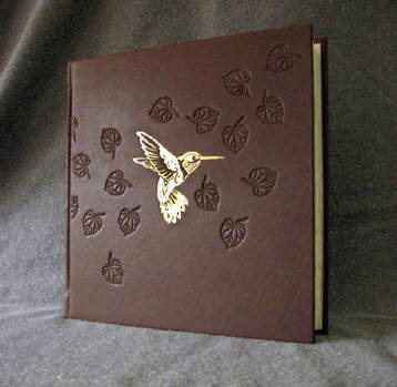 custom brown leather gold hummingbird and leaves album