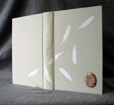 custom cloth and leather quail egg journal with feathers