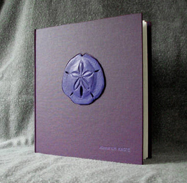 custom purple cloth and leather sand dollar journal