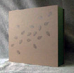 custom dark brown leather crane album with moon clamshell box with leaves front