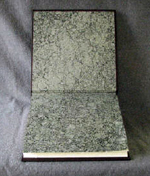 custom dark brown leather crane album with moon marbled endpapers