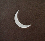 custom dark brown leather crane album with moon detail