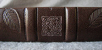dark brown leather dragonfly and leaves journal spine detail