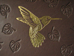 custom dark brown leather gold hummingbird album with leaves front detail