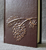 custom burgundy leather tall thin pinecone journal front detail