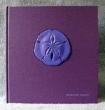 custom purple cloth and leather sand dollar book front