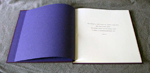 custom purple cloth and leather sand dollar book title page