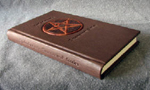 custom leather supernatural fan fiction binding with devils trap spine
