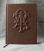 dark brown leather fraternity ceremony book with raised monogram