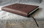 dark brown leather fraternity ceremony book with raised monogram spine