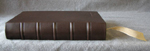traditional dark brown goatskin journal with raised cords