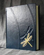 custom leather dragonfly and water ring book with leaf on the water front